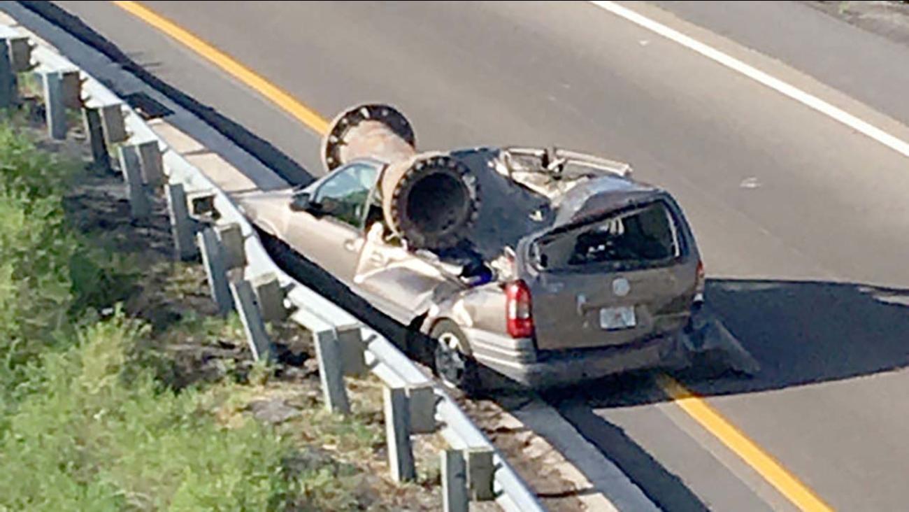A metal object flew off an overpass in Florida onto a van below