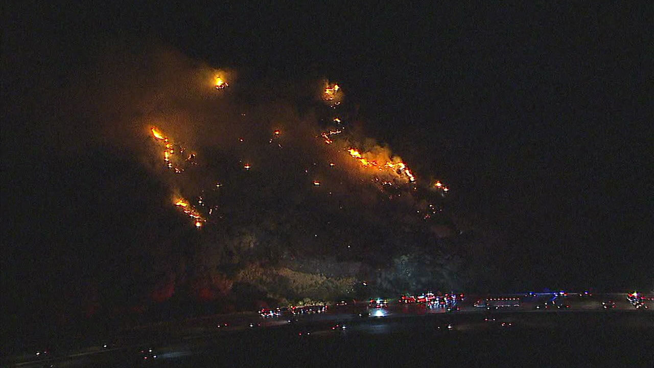 A brush fire burns in the hillsides of Simi Valley after a single-car crash on the side of the 118 Freeway sparked the blaze on Saturday, July 15, 2017.
