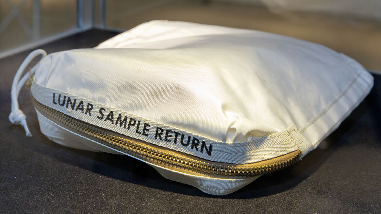 In this July 13, 2017 file photo, The Apollo 11 Contingency Lunar Sample Return Bag used by astronaut Neil Armstrong, to be offered at auction, is displayed at Sotheby's, in New York. (AP Photo/Richard Drew, File)