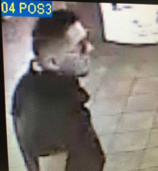 A surveillance image shows the suspect who robbed a McDonald's in Costa Mesa on Tuesday, July 25, 2017.