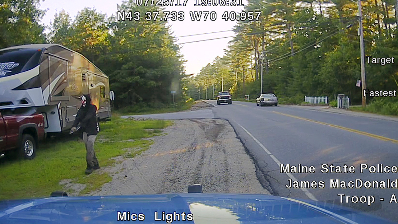 This Tuesday, July 25, 2017 patrol car dashboard camera image released by the Maine State Police shows a man strolling down a street in Hollis, Maine.