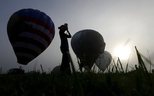 <div class='meta'><div class='origin-logo' data-origin='AP'></div><span class='caption-text' data-credit='AP Photo/Julio Cortez'>Zan Davies, of Bedminster, N.J., takes photographs of balloons during the first day of the New Jersey Festival of Ballooning, Friday, July 28, 2017, in Readington Township, NJ.</span></div>