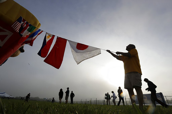 <div class='meta'><div class='origin-logo' data-origin='AP'></div><span class='caption-text' data-credit='AP Photo/Julio Cortez'>Micheal Caccavale, right, of Durham, N.Y., holds a line with flags while inflating the QuickChek Farmhouse balloon during the New Jersey Festival of Ballooning in Readington, NJ.</span></div>