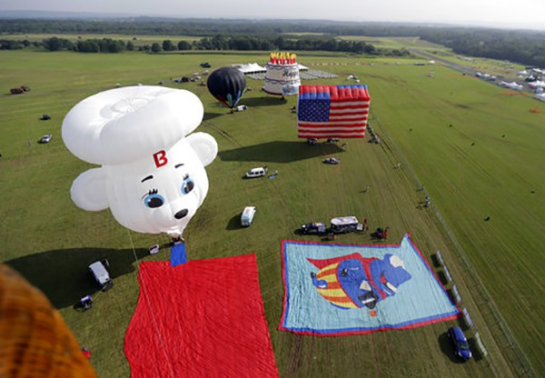 <div class='meta'><div class='origin-logo' data-origin='AP'></div><span class='caption-text' data-credit='AP Photo/Julio Cortez'>Balloons are seen on the grounds of the Solberg Airport during the first day of flight during the New Jersey Festival of Ballooning in Readington Township, NJ.</span></div>
