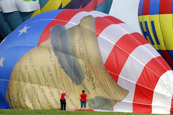 <div class='meta'><div class='origin-logo' data-origin='AP'></div><span class='caption-text' data-credit='AP Photo/Julio Cortez'>Women help deflate a balloon with a painting of the United States Constitution during the first day of the New Jersey Festival of Ballooning in Readington Township, NJ.</span></div>