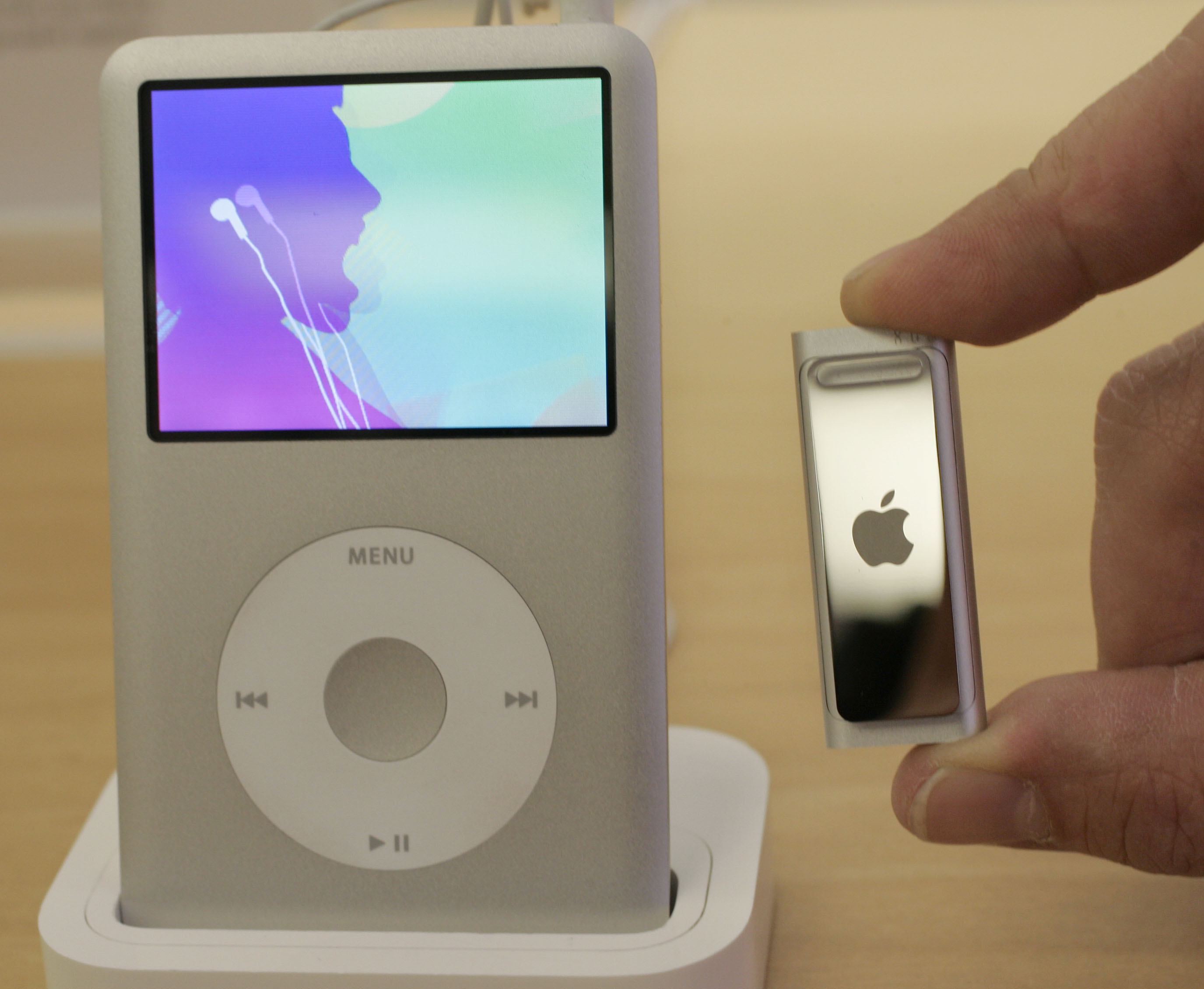 <div class='meta'><div class='origin-logo' data-origin='AP'></div><span class='caption-text' data-credit='AP Photo/Paul Sakuma'>Close up view of the new Apple iPod Shuffle, right, with the iPod Classic, left, at an Apple store in Palo Alto, Calif., Thursday, March 12, 2009.</span></div>