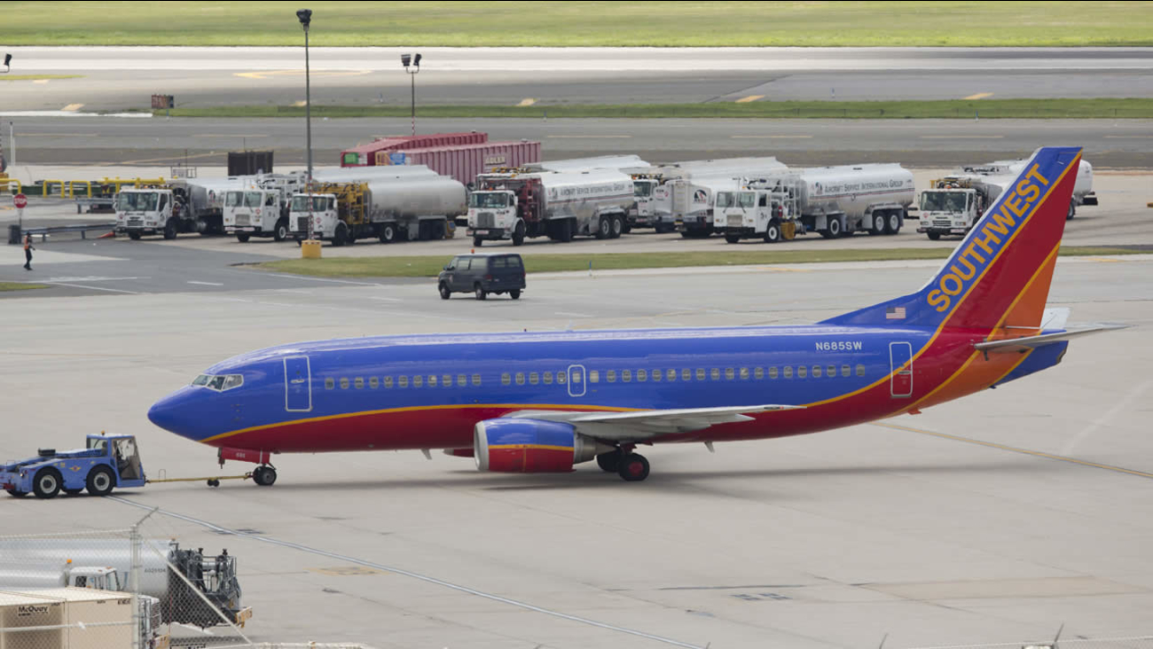 A Southwest Airlines airplane is pushed away from a terminal at the Philadelphia International Airport, Thursday, July 17, 2014, in Philadelphia. (AP Photo/Matt Rourke)
