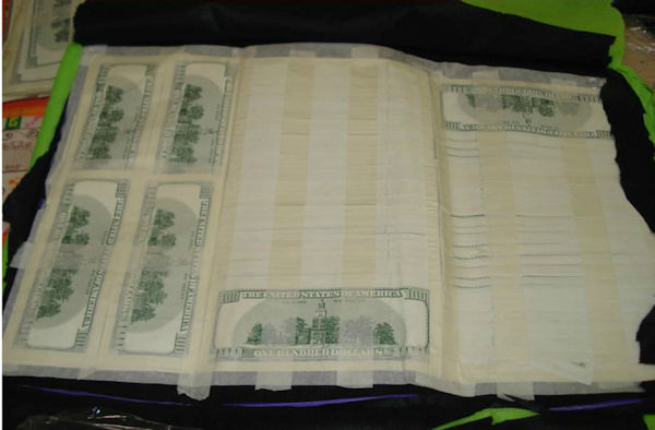 "<div class=""meta image-caption""><div class=""origin-logo origin-image ""><span></span></div><span class=""caption-text"">Photos of counterfeit money seized at JFK Airport on July 15 and 16, 2014.</span></div>"