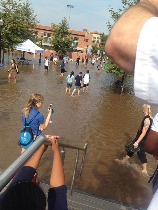 "<div class=""meta image-caption""><div class=""origin-logo origin-image ""><span></span></div><span class=""caption-text"">Students, unaware of the danger, snap photos of the encroaching water. (Bridgeyyy__ / Twitter)</span></div>"