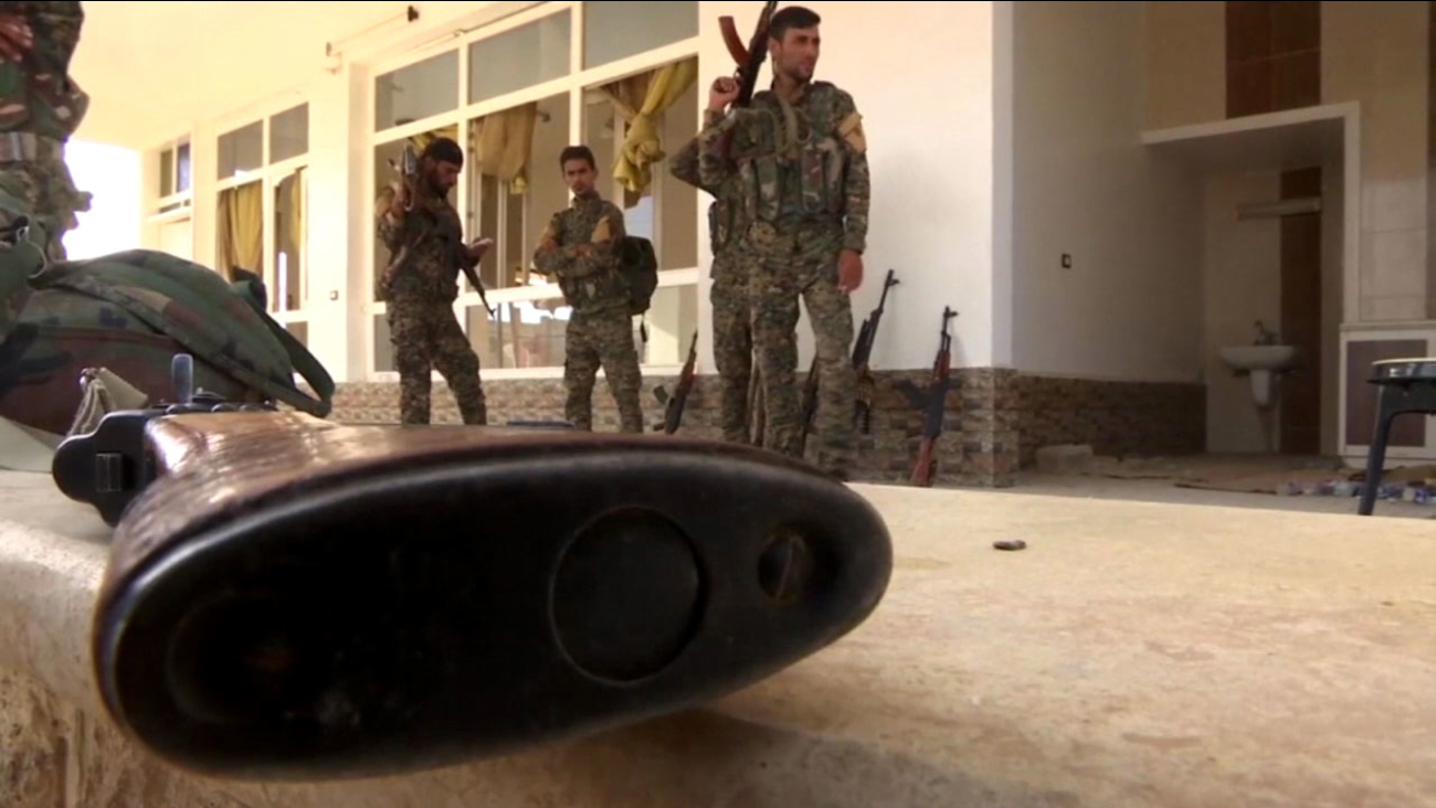 In image of a rifle and Syrian rebels is shown in an undated file photo.