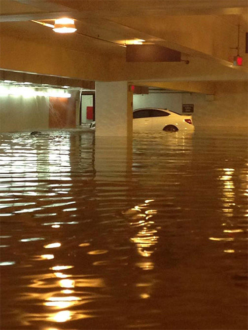 "<div class=""meta image-caption""><div class=""origin-logo origin-image ""><span></span></div><span class=""caption-text"">Parking garages four and seven took on a significant amount of water. (FutureNBAAgent / Twitter)</span></div>"