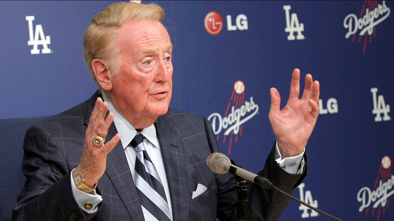 Vin Scully speaks during news conference, Friday Aug. 23, 2013, at Dodger Stadium in Los Angeles.