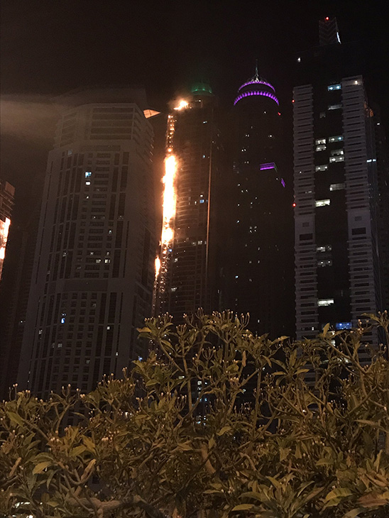 <div class='meta'><div class='origin-logo' data-origin='none'></div><span class='caption-text' data-credit='Dina Fouri/Twitter'>The 82-story Marina Torch building in Dubai has caught fire.</span></div>