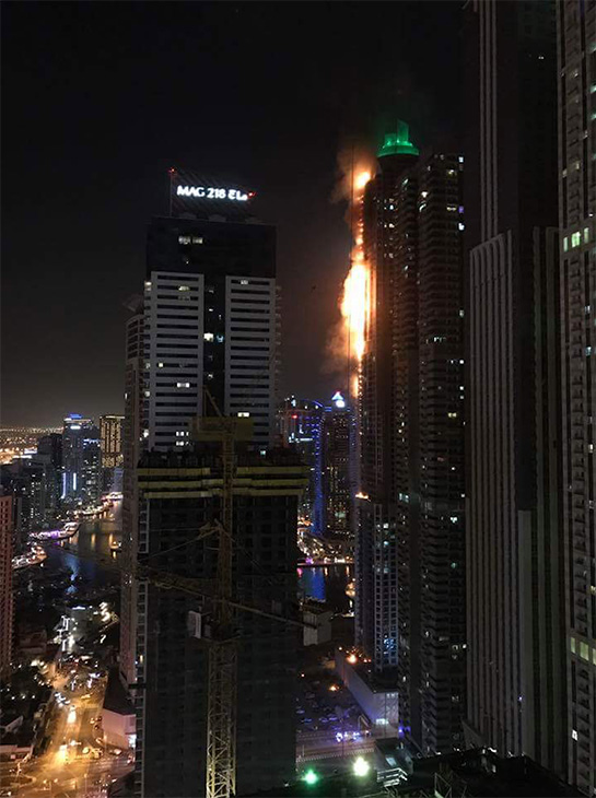 <div class='meta'><div class='origin-logo' data-origin='none'></div><span class='caption-text' data-credit='Ilsam Park/Facebook'>The 82-story Marina Torch building in Dubai has caught fire.</span></div>