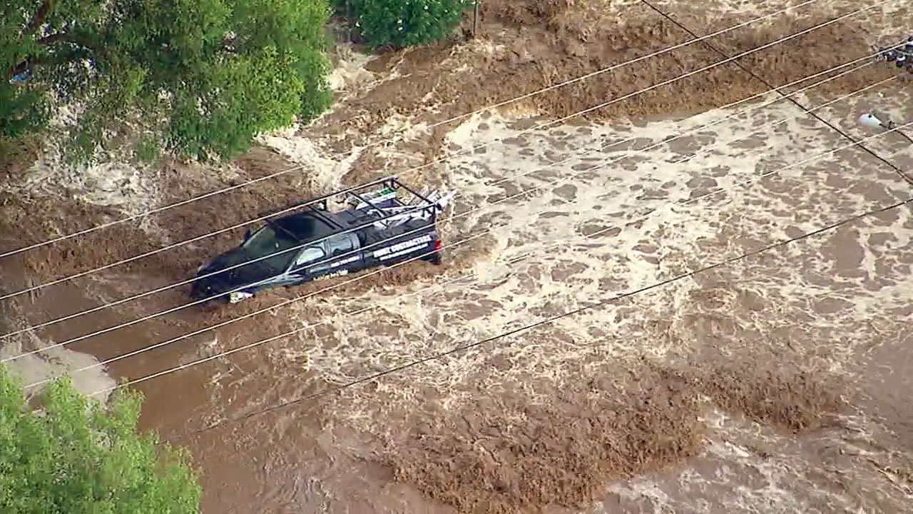 Vehicles were caught in a river of mud from a flash flood in Acton on Thursday, Aug. 3, 2017.