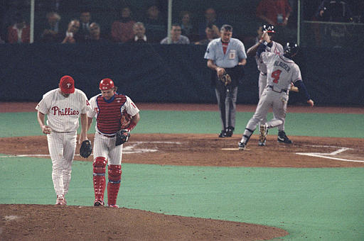 <div class='meta'><div class='origin-logo' data-origin='AP'></div><span class='caption-text' data-credit=''>Phillies pitcher Tommy Greene, left, confers with teammate Darren Daulton on the mound during Game 2 of the National League Playoffs at Veterans Stadium, Thursday, Oct. 7, 1993.</span></div>