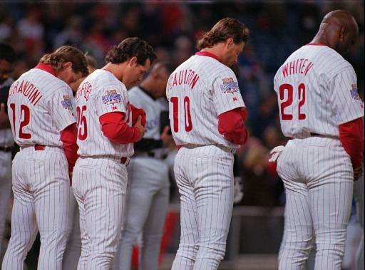 <div class='meta'><div class='origin-logo' data-origin='AP'></div><span class='caption-text' data-credit=''>Mickey Morandini, Gregg Jefferies, Darren Daulton and Mark Whiten bow their heads during a moment of silence for umpire John McSherry Tuesday, April 2, 1996.</span></div>