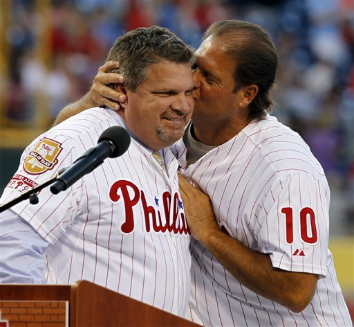 "<div class=""meta image-caption""><div class=""origin-logo origin-image ap""><span>AP</span></div><span class=""caption-text"">John Kruk, left, is kissed by teammate Darren Daulton during a ceremony to enshrine Kruk in the Phillies Wall of Fame, Friday, Aug. 12, 2011. (AP Photo/Alex Brandon) (ASSOCIATED PRESS)</span></div>"