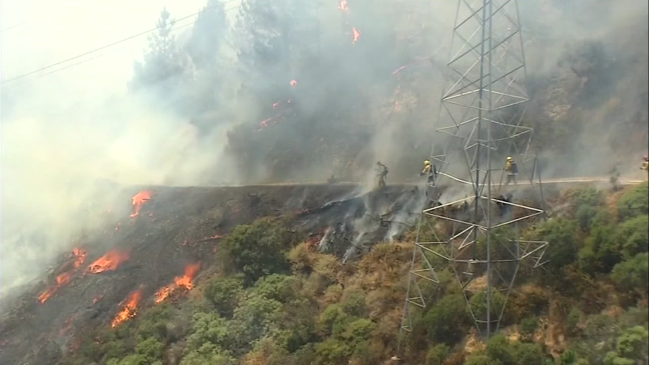 A brush fire burns near Grizzly Peak Boulevard in the Oakland Hills on Wednesday, August 2, 2017.