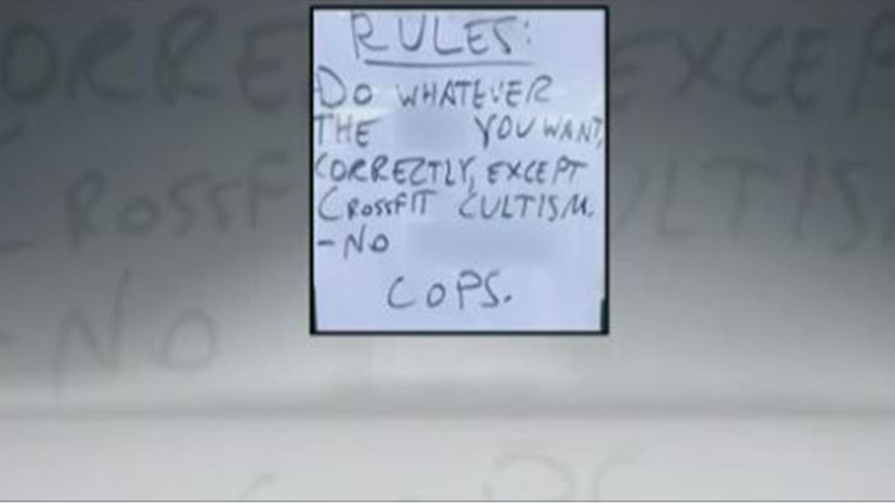 This sign, banning cops and CrossFit, was hung outside of a Georgia gym