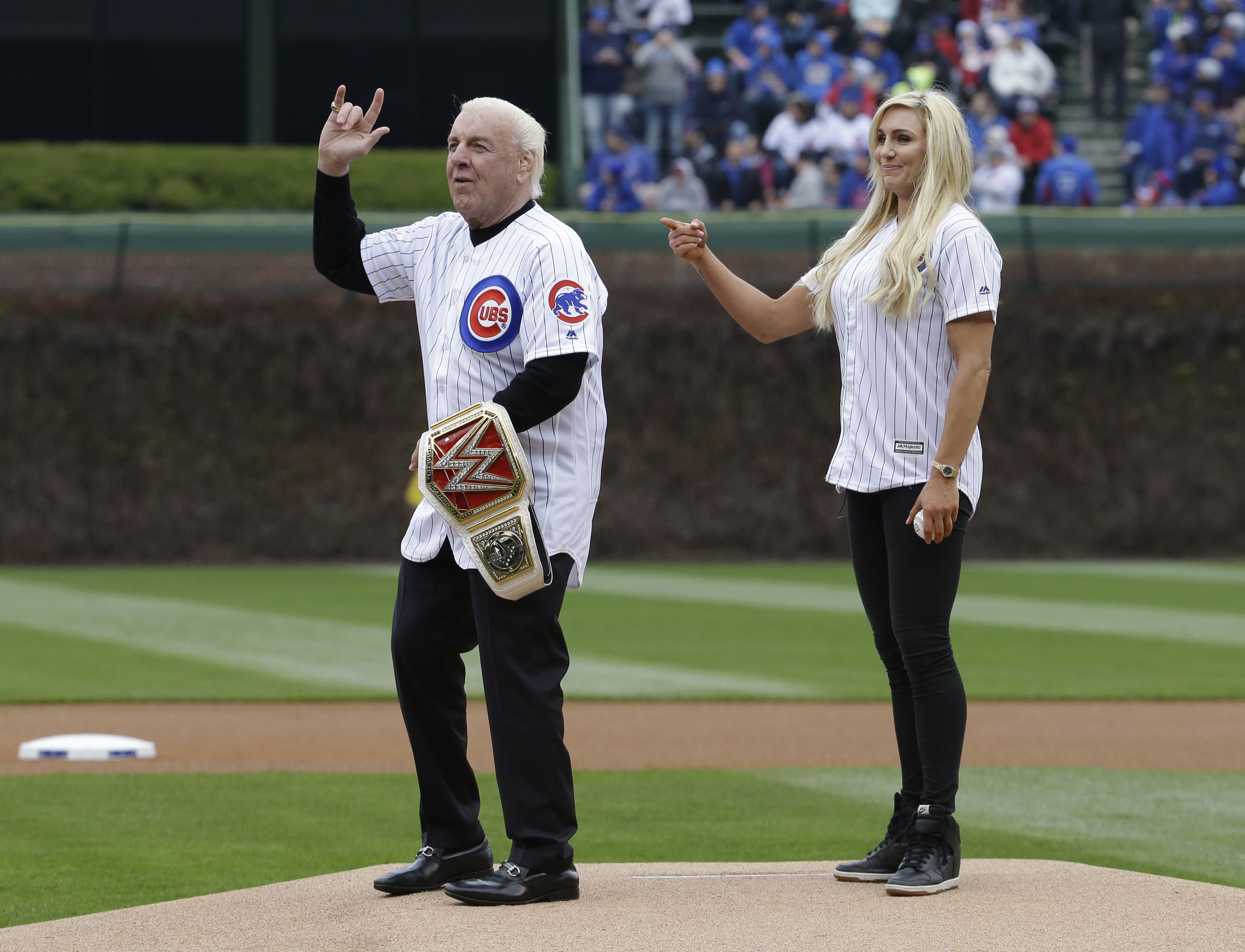 <div class='meta'><div class='origin-logo' data-origin='none'></div><span class='caption-text' data-credit=''>Ric Flair and his daughter Miss Charlotte before throwing out a ceremonial first pitch at an Atlanta Braves game, May 1, 2016, in Chicago. (AP Photo/Nam Y. Huh)</span></div>
