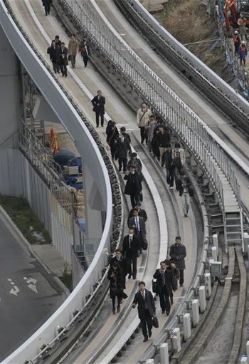 """<div class=""""meta image-caption""""><div class=""""origin-logo origin-image """"><span></span></div><span class=""""caption-text"""">Yurikamome train passengers walk on the elevated track towards Shiodome Station in Tokyo's Shiodome district near Tokyo Bay Friday, March 11, 2011, shortly after a 7.9-magnitude earthquake has struck off Japan's northeastern coast. (AP Photo/Koji Sasahara) (AP Photo/Koji Sasahara)</span></div>"""