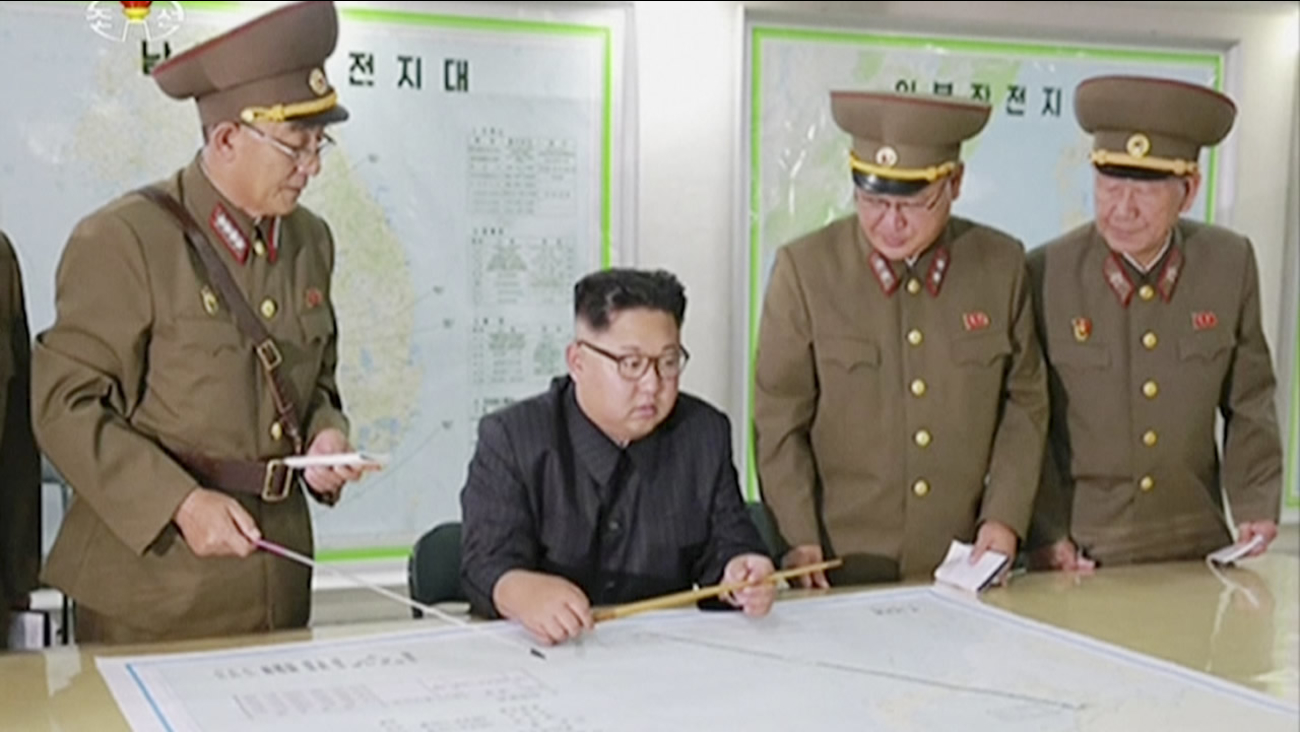 This image made from video on Aug. 14, 2017, shows North Korean leader Kim Jong Un receiving a briefing in Pyongyang. (KRT via AP Video)