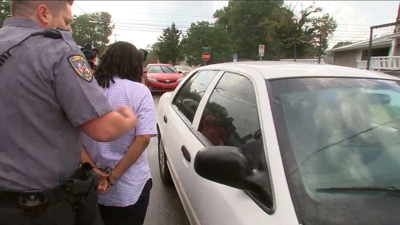 Deputies take Takiyah Thompson into custody Tuesday.