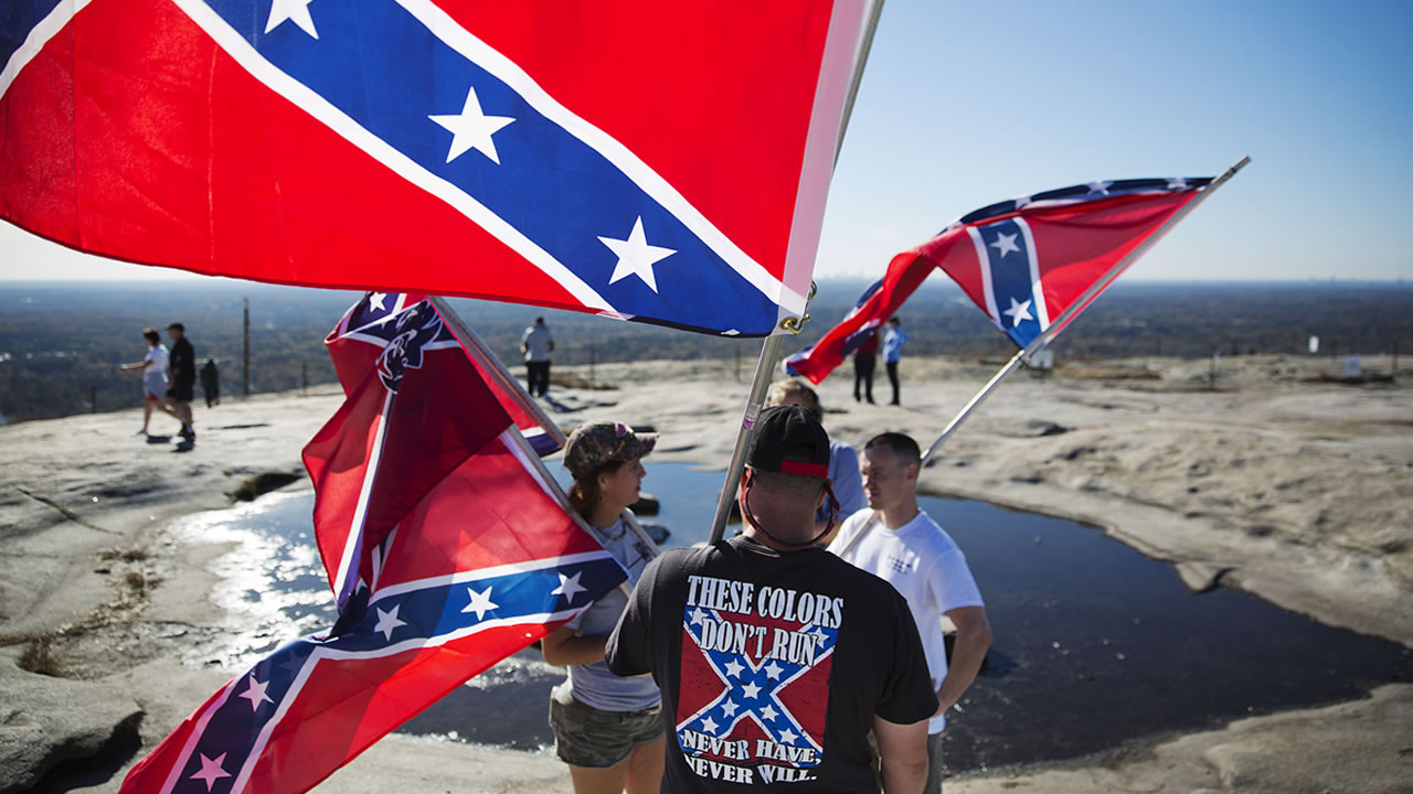Confederate flag supporters gather at the top of Stone Mountain Nov. 14, 2015, in Stone Mountain, Ga. (AP Photo/David Goldman)