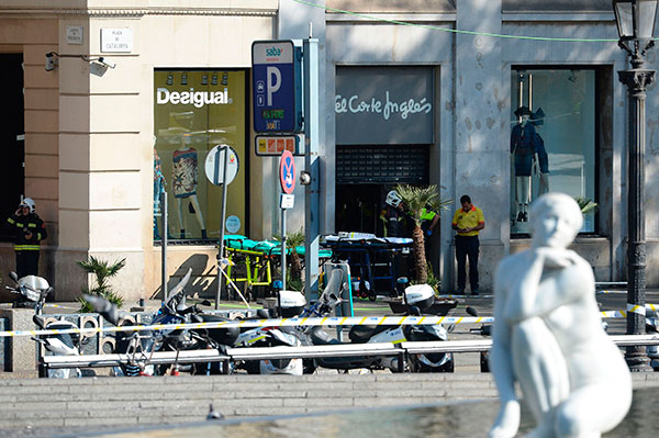 "<div class=""meta image-caption""><div class=""origin-logo origin-image none""><span>none</span></div><span class=""caption-text"">Firefighters stands outside an evacuated mall after a van plowed into a crowd, injuring pedestrians in Barcelona on August 17, 2017. (JOSEP LAGO/AFP/Getty Images)</span></div>"