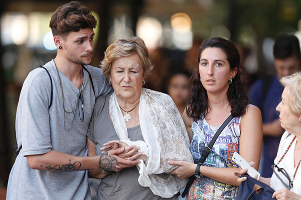 "<div class=""meta image-caption""><div class=""origin-logo origin-image none""><span>none</span></div><span class=""caption-text"">People comfort each other after a van ploughed into the crowd, killing two persons and injuring several others on the Rambla in Barcelona on August 17, 2017. (PAU BARRENA/AFP/Getty Images)</span></div>"