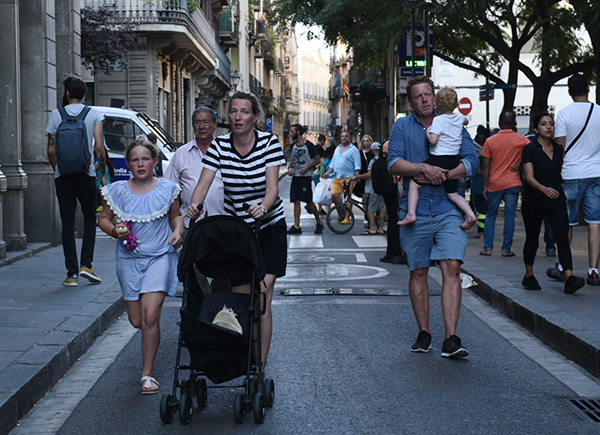 <div class='meta'><div class='origin-logo' data-origin='none'></div><span class='caption-text' data-credit='AP Photo/Giannis Papanikos'>People flee the scene in Barcelona after a white van jumped the sidewalk in the historic Las Ramblas district, crashing into a summer crowd of residents.</span></div>