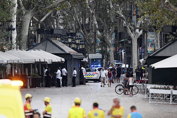 <div class='meta'><div class='origin-logo' data-origin='none'></div><span class='caption-text' data-credit='David Ramos/Getty Images)'>A general view of the scene of a terrorist attack in the Las Ramblas area on August 17, 2017 in Barcelona, Spain</span></div>