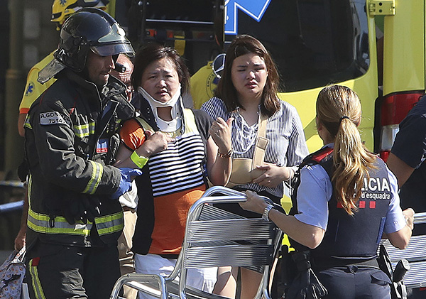 <div class='meta'><div class='origin-logo' data-origin='none'></div><span class='caption-text' data-credit='AP Photo/Oriol Duran'>Injured people are treated in Barcelona after a white van jumped the sidewalk in the historic Las Ramblas district, crashing into a summer crowd of residents.</span></div>