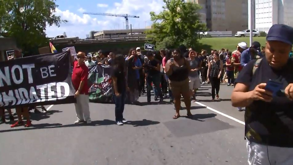 <div class='meta'><div class='origin-logo' data-origin='WTVD'></div><span class='caption-text' data-credit=''>Protesters marching in downtown Durham Friday</span></div>