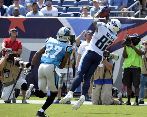 "<div class=""meta image-caption""><div class=""origin-logo origin-image ap""><span>AP</span></div><span class=""caption-text"">Panthers defensive back Mike Adams gets beat by Titans tight end Delanie Walker for a 4-yard touchdown pass. (Mark Zaleski)</span></div>"