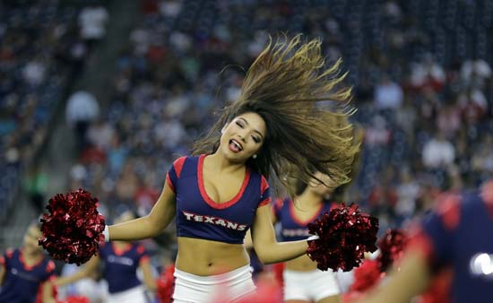 <div class='meta'><div class='origin-logo' data-origin='AP'></div><span class='caption-text' data-credit='David J. Phillip'>Houston Texans cheerleaders perform before an NFL football preseason game against the New England Patriots Saturday, Aug. 19, 2017, in Houston.</span></div>