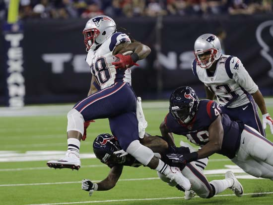 <div class='meta'><div class='origin-logo' data-origin='AP'></div><span class='caption-text' data-credit='David J. Phillip'>New England Patriots running back Brandon Bolden (38) turns the corner during the second half.</span></div>