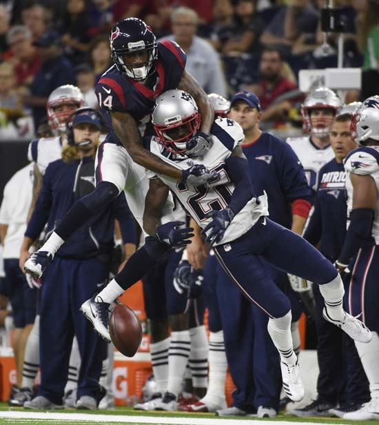 <div class='meta'><div class='origin-logo' data-origin='AP'></div><span class='caption-text' data-credit='Eric Christian Smith'>New England Patriots cornerback Justin Coleman (22) breaks up a pass intended for Houston Texans wide receiver Chris Thompson (14) during the second half.</span></div>