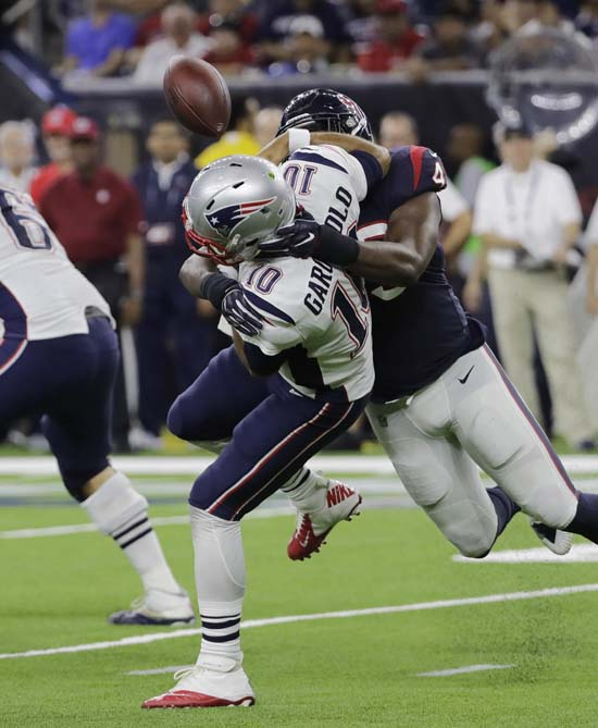 <div class='meta'><div class='origin-logo' data-origin='AP'></div><span class='caption-text' data-credit='David J. Phillip'>New England Patriots quarterback Jimmy Garoppolo (10) fumbles the ball as he is hit by Houston Texans outside linebacker Tony Washington (49) during the second half.</span></div>