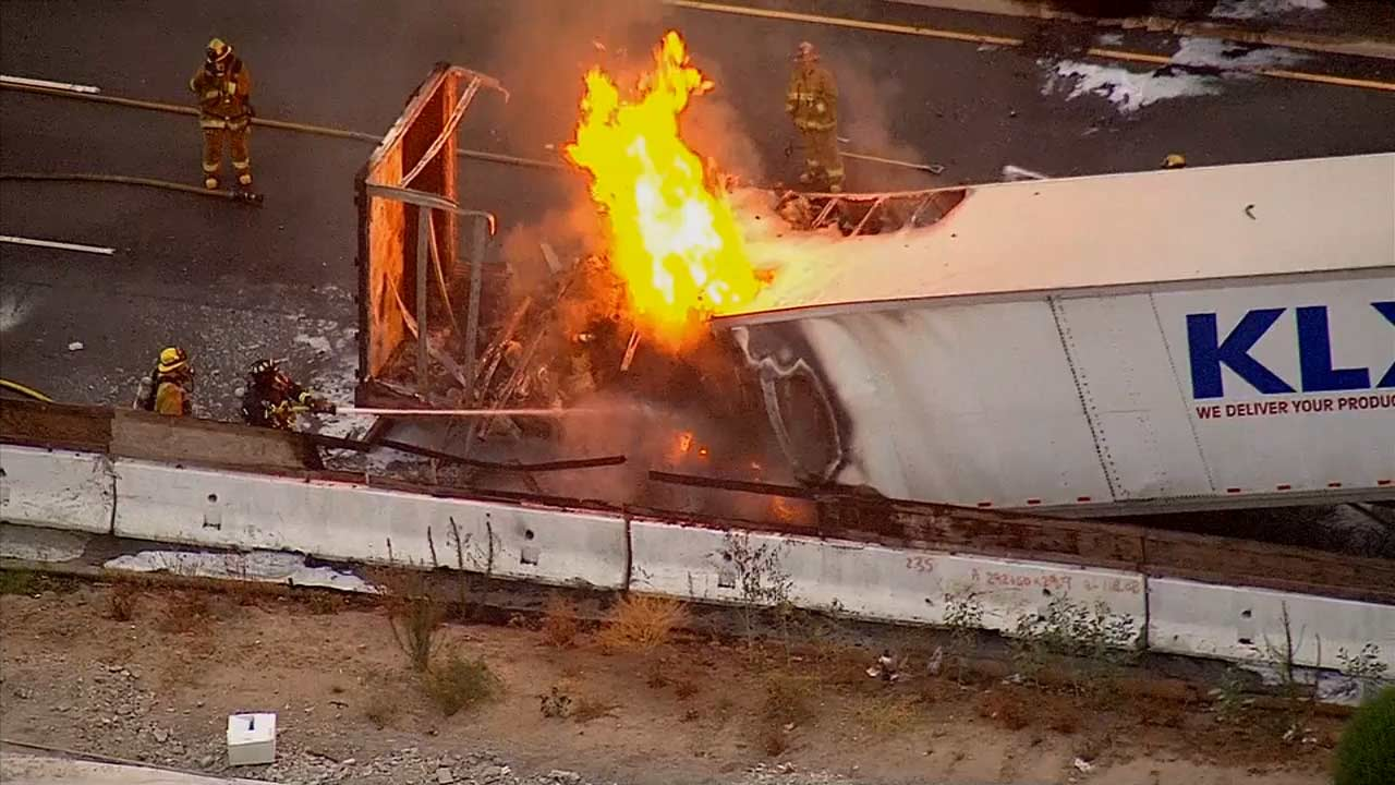 A big rig fire shut down southbound lanes of the 5 Freeway in Norwalk on Friday, Aug. 1, 2014.