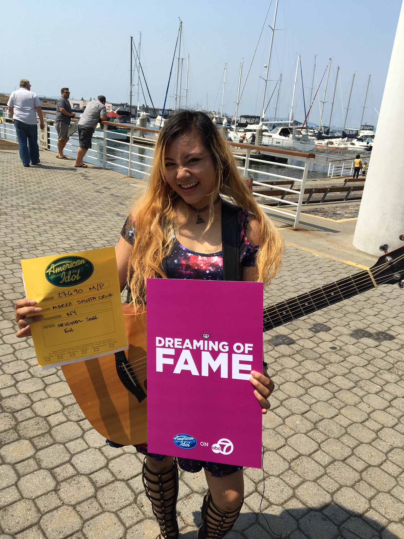"<div class=""meta image-caption""><div class=""origin-logo origin-image none""><span>none</span></div><span class=""caption-text"">An ""American Idol"" hopeful holds up her golden ticket after passing a round of auditions in Oakland, Calif. on Sunday, Aug. 20, 2017. (KGO-TV)</span></div>"