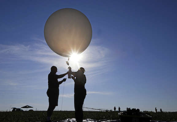 "<div class=""meta image-caption""><div class=""origin-logo origin-image kfsn""><span>kfsn</span></div><span class=""caption-text"">Mike Newchurch, left, professor of atmospheric chemistry at the University of Alabama in Huntsville, and graduate student Paula Tucker prepare a weather balloon. (AP Photo/Mark Humphrey)</span></div>"