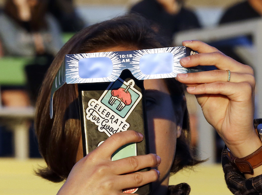"<div class=""meta image-caption""><div class=""origin-logo origin-image kfsn""><span>kfsn</span></div><span class=""caption-text"">Catalina Gaitan, from Portland, Ore., tries to shoot a photo of the rising sun through her eclipse glasses at a gathering of eclipse viewers in Salem, Ore., Monday, Aug. 21, 2017. (AP Photo/Don Ryan)</span></div>"