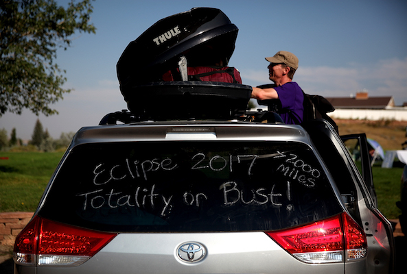 <div class='meta'><div class='origin-logo' data-origin='Creative Content'></div><span class='caption-text' data-credit='Justin Sullivan/Getty'>Brian Marriott of Boston, Massachusetts looks in a storage container on top of his car before watching the solar eclipse at South Mike Sedar Park on August 21, 2017.</span></div>