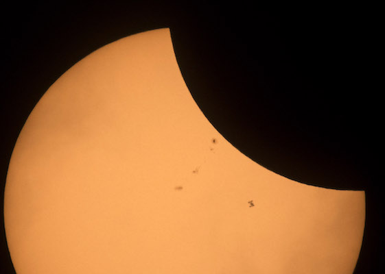 <div class='meta'><div class='origin-logo' data-origin='Creative Content'></div><span class='caption-text' data-credit='Joel Kowsky/NASA via Getty'>In this NASA handout, the International Space Station (bottom right), with a crew of six onboard, is seen in silhouette as it transits the Sun.</span></div>