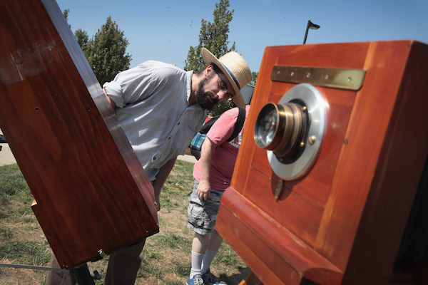 <div class='meta'><div class='origin-logo' data-origin='Creative Content'></div><span class='caption-text' data-credit='Scott Olson/Getty'>C. D. Olsen adjusts one of his vintage style cameras which he plans to use during the total solar eclipse on the campus of Southern Illinois University on August 21, 2017.</span></div>