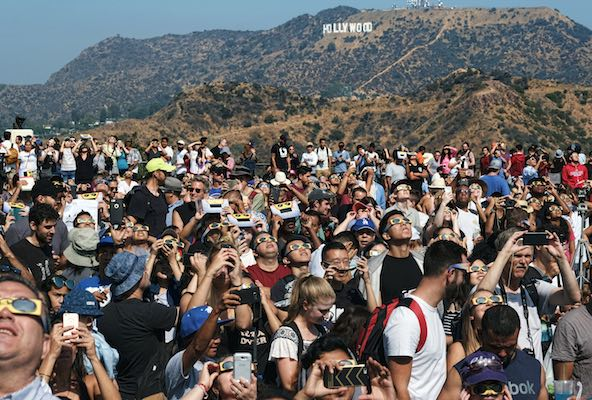 "<div class=""meta image-caption""><div class=""origin-logo origin-image kabc""><span>kabc</span></div><span class=""caption-text"">A crowd gathers in front of the Hollywood sign at the Griffith Observatory to watch the solar eclipse in Los Angeles on Monday, Aug. 21, 2017. (AP Photo/Richard Vogel)</span></div>"