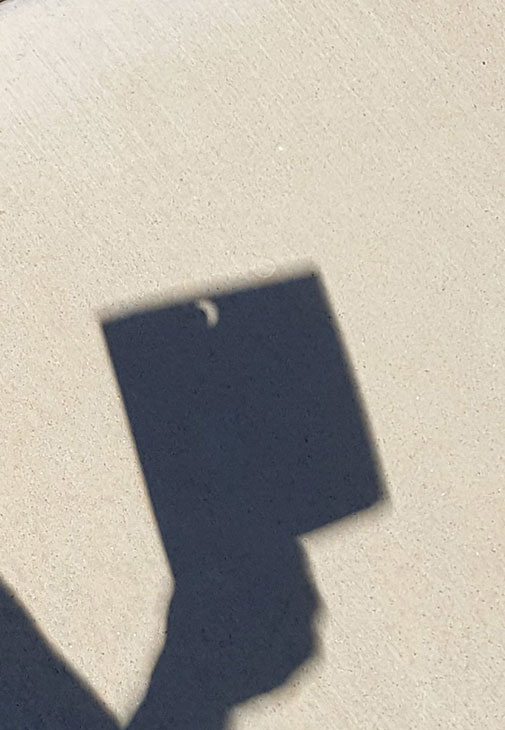 "<div class=""meta image-caption""><div class=""origin-logo origin-image kabc""><span>KABC</span></div><span class=""caption-text"">The Great American Eclipse transforms a hole in a paper into the shape of a half-moon on Monday, Aug. 21, 2017. (Lera Bishop/Twitter)</span></div>"