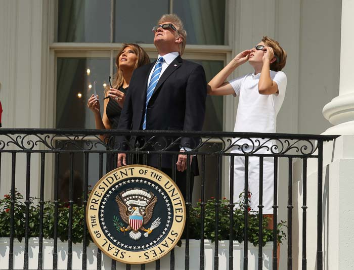 "<div class=""meta image-caption""><div class=""origin-logo origin-image kfsn""><span>kfsn</span></div><span class=""caption-text"">President Donald Trump, first lady Melania Trump and their son Barron watch the solar eclipse from the White House. (Andrew Harnik/AP)</span></div>"